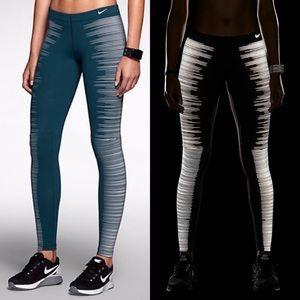 NIKE • RARE teal stripe flash reflective leggings